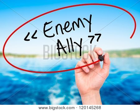 Man Hand Writing Enemy - Ally With Black Marker On Visual Screen.
