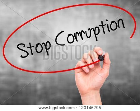 Man Hand Writing Stop Corruption With Black Marker On Visual Screen.