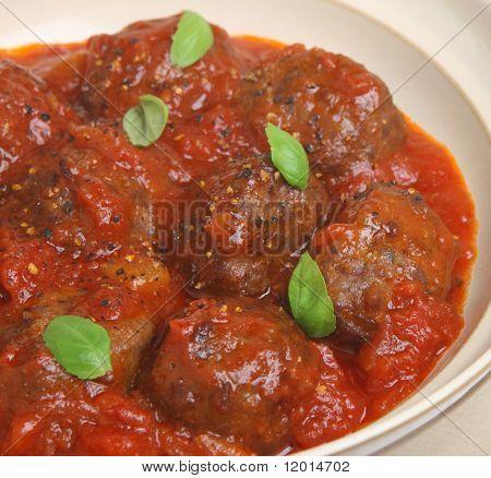 Italian meatballs in tomato and basil sauce.