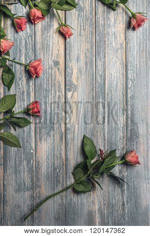 Grunge Wooden Background With Pink Roses