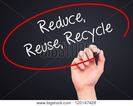 Man Hand Writing Reduce Reuse Recycle With Black Marker On Visual Screen.