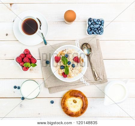 healthy fitness breakfast with muesli and berries
