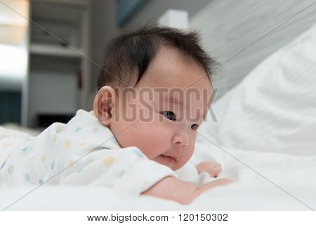 Asian Baby On Bed