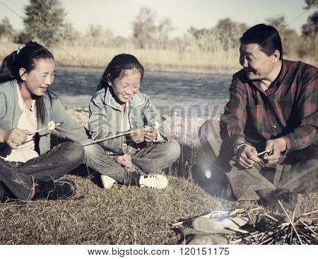Mongolian Family Enjoy Camping River Leisure Concept