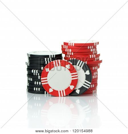 Stacks of casino chips isolated on white background