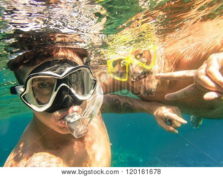 Adventurous Best Friends Taking Selfie Snorkeling Underwater - Adventure Travel Lifestyle Enjoying