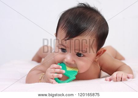 Cute Asian Baby Girl Biting Rubber Toy