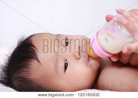 Cute Asian Baby Girl Bottle Feeding