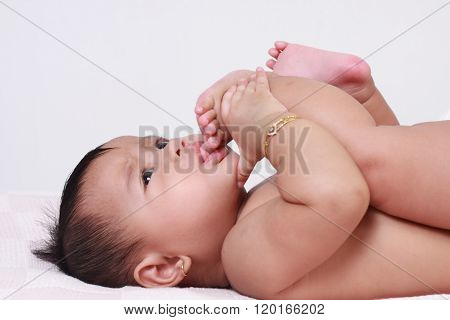 Cute Asian Baby Girl Sucking Her Toes