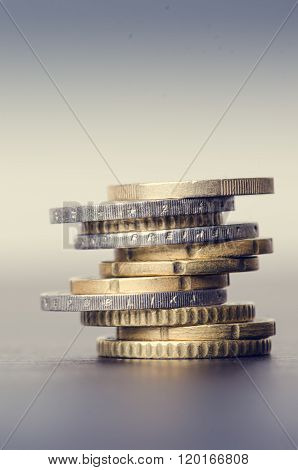 Euro money. Coins are isolated on a dark background. Currency of Europe. Balance of money. Building