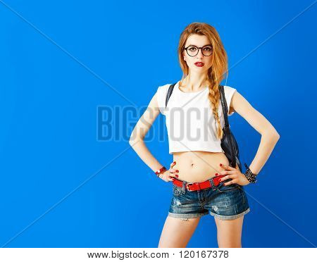 Sexy Student Hipster Girl on Blue Background