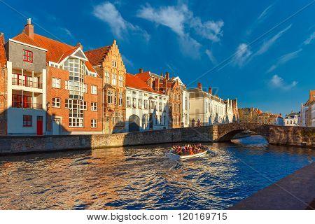 Tourist boat on Bruges canal Spiegelrei, Belgium