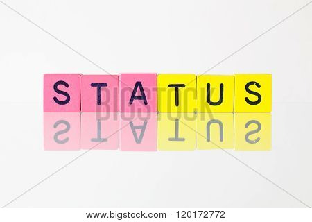 Status - an inscription from children's wooden blocks