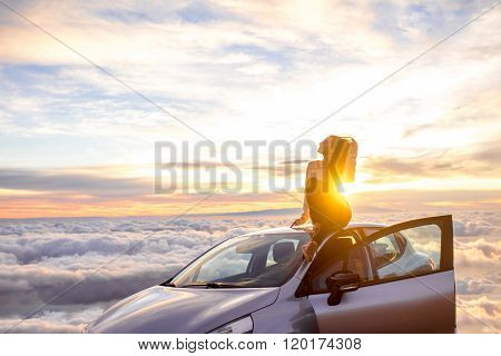 Woman enjoying beautiful cloudscape