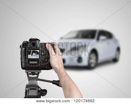 Hands Holding A Professional Camera On Tripod Taking Picture