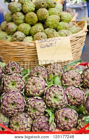 Green and purple fresh artichokes on the market in Rome