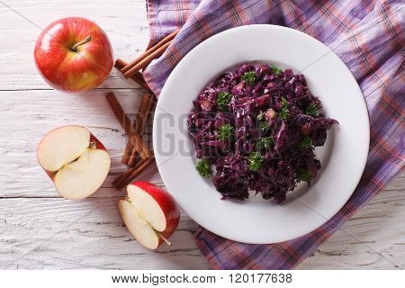 Braised Red Cabbage With Apples And Cinnamon Close-up. Horizontal Top View