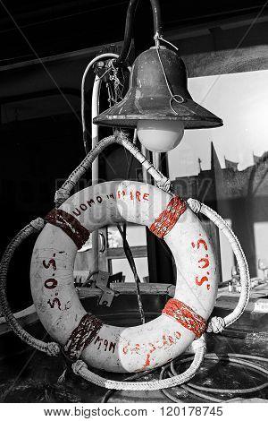 Lifebuoy and retro nautical lantern