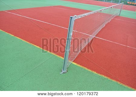 Close-up View Of A Rubber Broken Tennis Net. Untidy Land