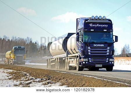 Two Scania Tank Trucks Platoon Along Spring Highway