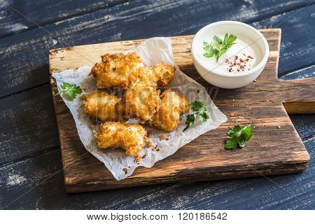 Crispy Fried Fish On A Wooden Rustic Board
