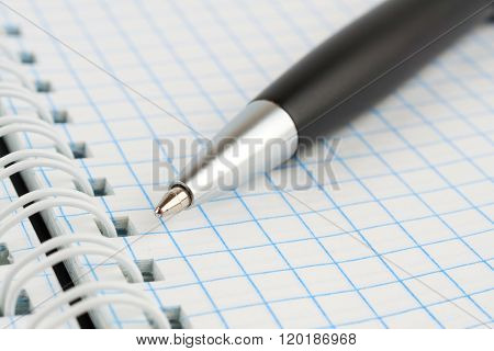 Black Ballpoint Pen On A Notepad With Spring