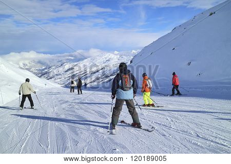 Downhill skiing on Three Valleys French Alps ski resort slopes