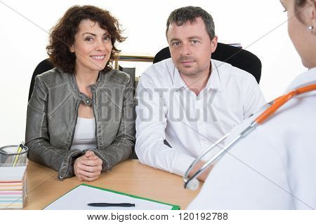 Doctor Female Meeting Couple In A Hospital Office