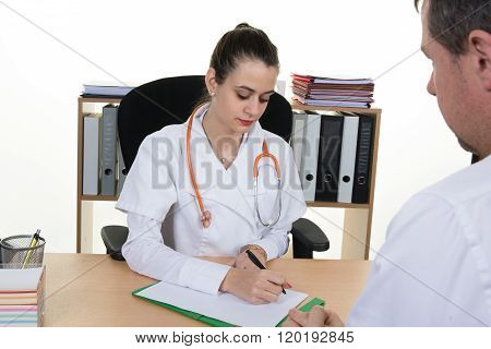 Confident Female Young Doctor Discussing Diagnosis With Male Patient