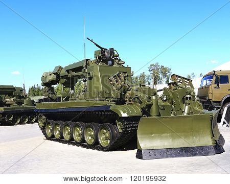 MOSCOW REGION  -   JUNE 18:Armored obstacle clearing engineer vehicle with dipper and crane. Destinated to perform engineering work for the promotion of troops equipment cross-country routes  -  on June 18, 2015 in Moscow region
