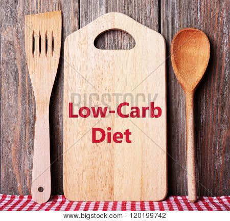Text Low-Carb Diet on cutting board on wooden planks background