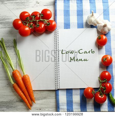 Text Low-Carb Menu in recipe book on wooden background