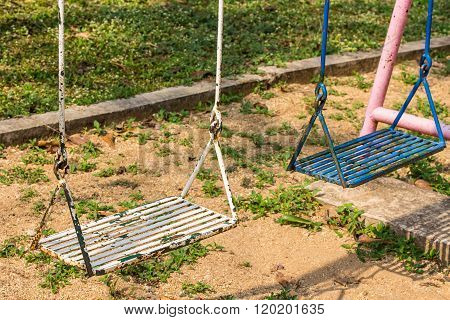 Closeup Of Swings In A Playground