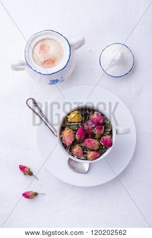 Cup of pink roses tea