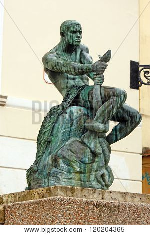 Fisherman With Snake, Statue