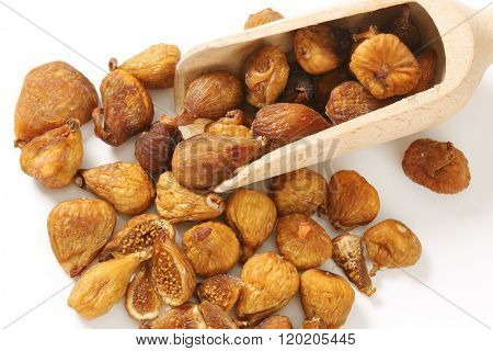 scoop of sun dried figs on white background