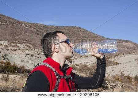 Thirsty Mountaineer Drinking Water