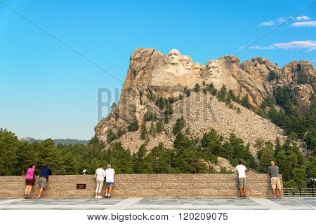 Tourists Looking At Mount Rushmore