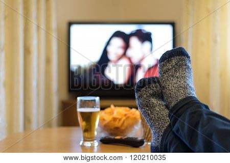 Tv, Television Watching (romance Movie) With Feet On The Table And Snacks