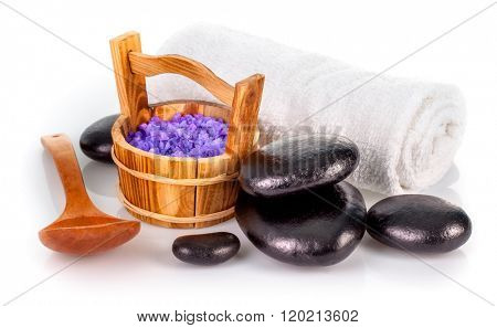 Spa still life with lavender salt black stone and white towel isolated on background