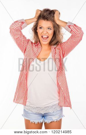 Portrait Of Crazy Girl  Holding Her Hair And Screaming