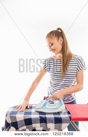 Young Cheerful Woman Ironing Her Clothes On The  Board
