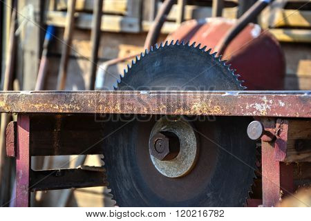 Close Up Of Table Circular Saw Blade In Workshop. Woodwork, Work Hazards. Dangerous Serrated Tablesa