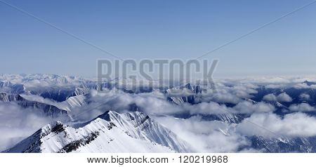 Panoramic View On High Mountains In Haze