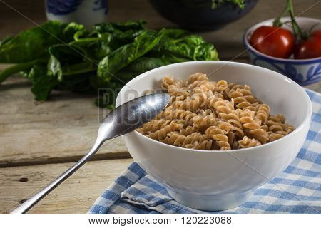 Healthy Whole Grain Pasta, Cooked Spiral Noodles From Whole Grain Spelt  In A Bowl On A Rustic Woode