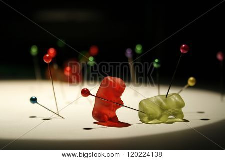 Two gummy bear with pins