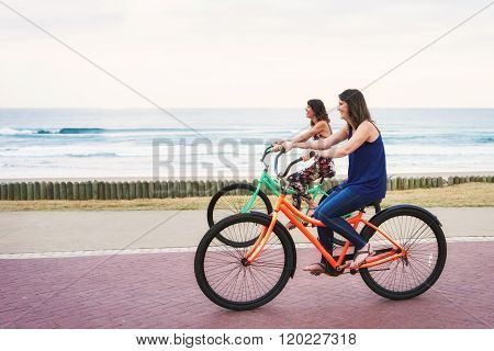 Sisters riding bicycles beside each other