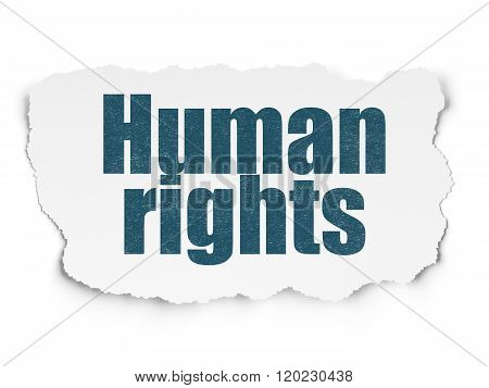 Political concept: Human Rights on Torn Paper background