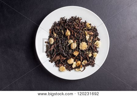 Tea Asian Flowers Oolong On White Plate On Dark Backgroung