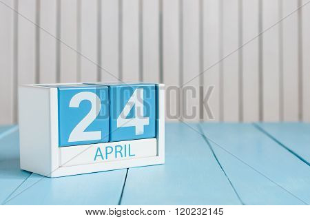 April 24th. Image of april 24 wooden color calendar on white background.  Spring day, empty space fo